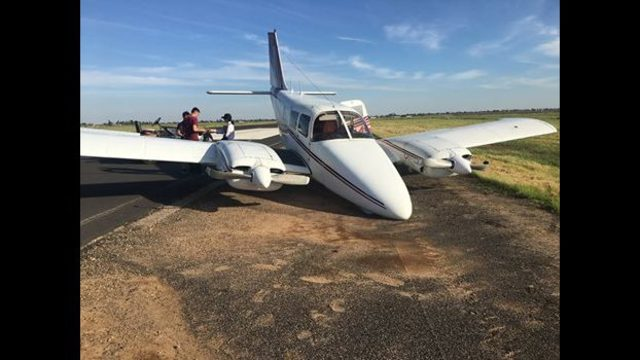 Plane drifts off runway after apparent landing gear malfunction in Madera