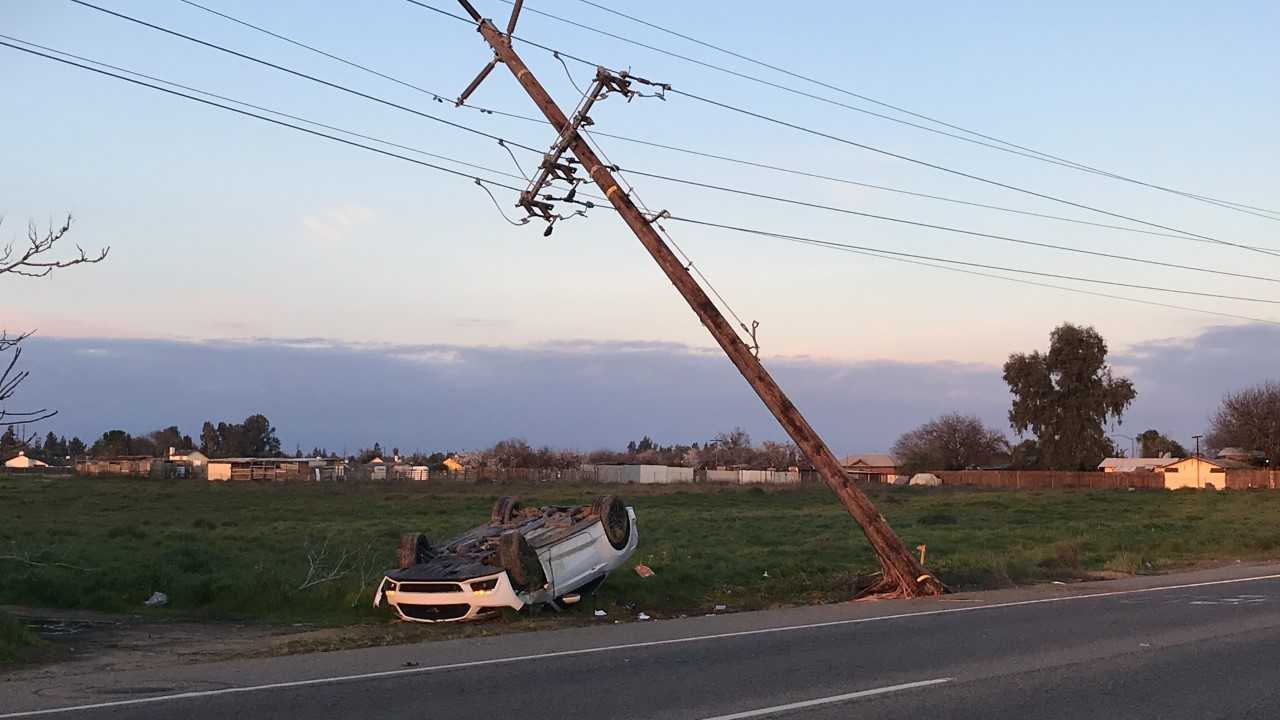 Rollover accident knocks down power pole